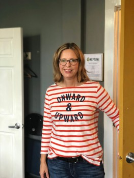 """Elizabeth wears her """"Onward & Upward"""" shirt before our show at the Neptune Theatre in Seattle"""